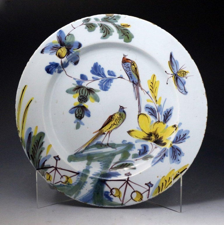An excellent pair of delftware dishes decorated with birds, flowers, and insects in polychrome colors. The rare pair have wonderful decorative appeal and are the work of the Bristol pottery from the mid-18th century. Bristol, England,