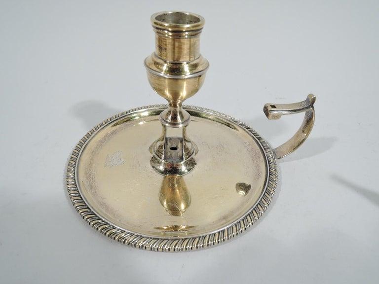 Sterling Silver Pair of English Georgian Regency Silver Gilt Chambersticks For Sale