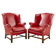 Pair of English Georgian Style Ruby Red Leather Wingback Chairs