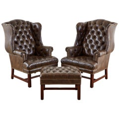 Pair of English Georgian Style Tufted Leather Wingbacks with Ottoman