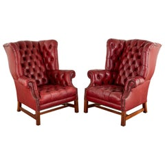 Pair of English Georgian Tufted Red Leather Wingback Chairs