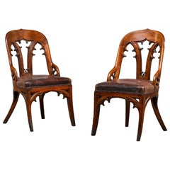 Pair of English Gothic Carved Oak Chairs
