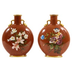 Pair of English Mintons Coral Ground Floral Motif Moon Flasks with Gilding