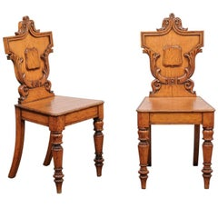 Pair of English Oak Hall Chairs with Carved Shield Backs and Cartouches, 1890s