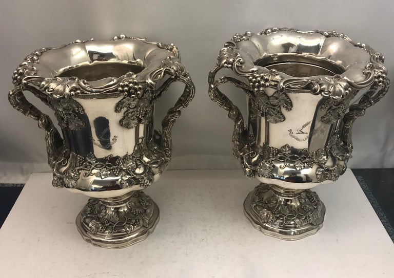 A matching pair of old Sheffield wine coolers, decorated with grapes and vines from the 19th century.