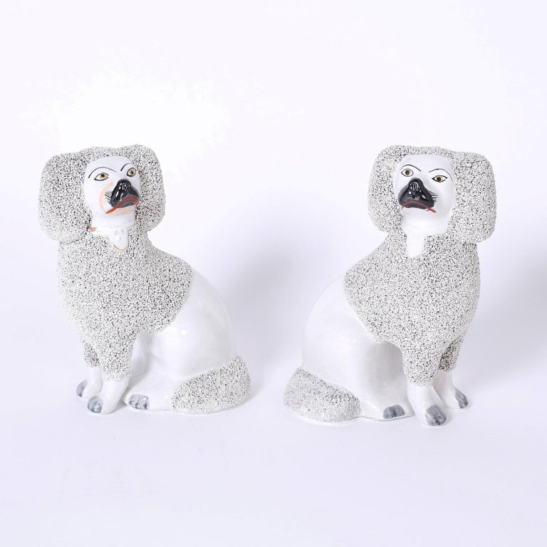 Antique pair of Staffordshire poodles cast in a press mold with English clay and in remarkable condition.