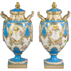 Pair of English Porcelain Two Handled Covered Vases, circa 1850