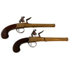 Pair of English Queen Anne Brass Pistols