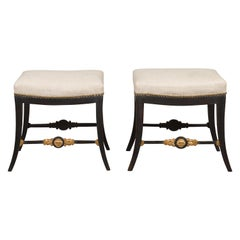 Pair of English Regency 1820s Ebonized and Gilt Stools with New Upholstery