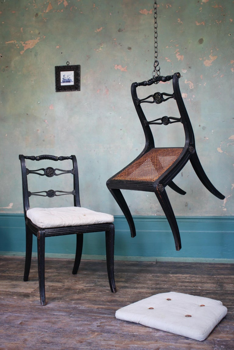 Pair of English Regency Ebonised Caned Klismos Side Chairs with Original Squabs For Sale 7