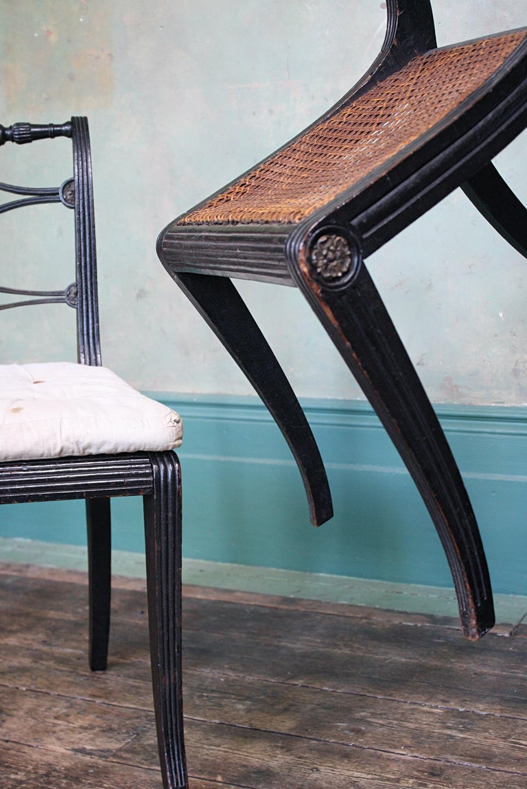 Pair of English Regency Ebonised Caned Klismos Side Chairs with Original Squabs For Sale 8