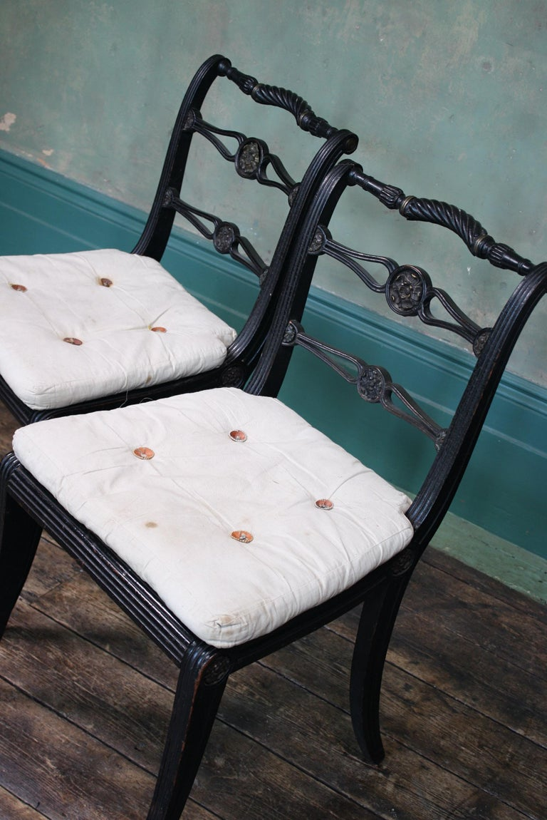 Pair of English Regency Ebonised Caned Klismos Side Chairs with Original Squabs For Sale 13