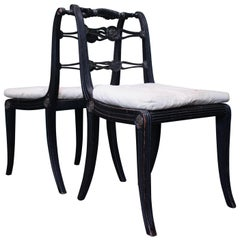 Pair of English Regency Ebonised Caned Klismos Side Chairs with Original Squabs