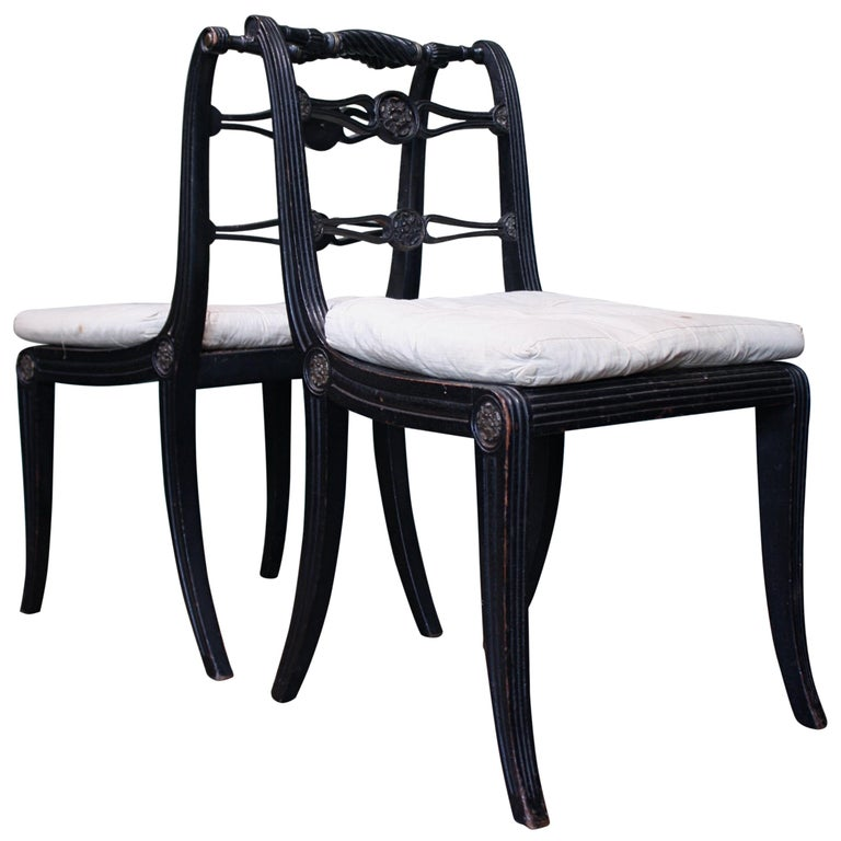 Pair of English Regency Ebonised Caned Klismos Side Chairs with Original Squabs For Sale