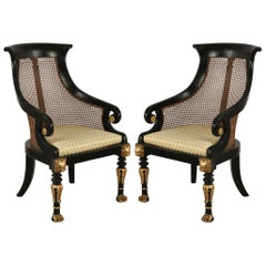 Pair of English Regency Style Carved Black and Gilt Cane Back Armchairs