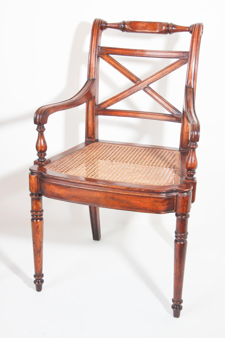Hand-Carved Pair of English Regency Style Library Cane Armchairs For Sale