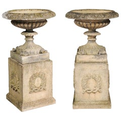 Pair of English Stone Garden Urns on Pedestals with Laurel Wreaths and Gadroons