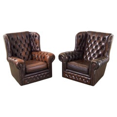 Pair of English Thomas Lloyd Cigar Leather Chesterfield Wingback Chairs