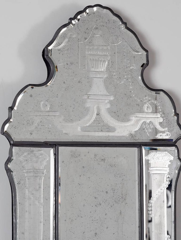 Pair of engraved bevelled edge sconces with hand bevelled back and hand engraved panels