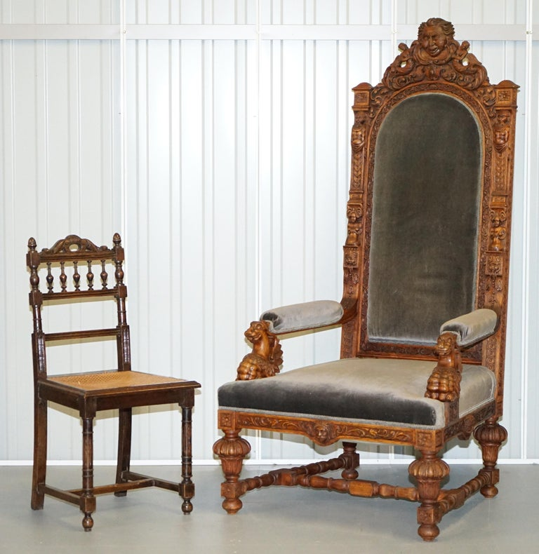 We are delighted to offer for sale this pair of absolutely enormous Jacobean revival Victorian hand carved English oak throne armchairs   A very decorative and well made pair, hand carved from solid slabs of English oak, the top crests depict