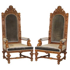 Pair of Enormous Victorian Jacobean Revival Cherub Putti Carved Throne Armchairs
