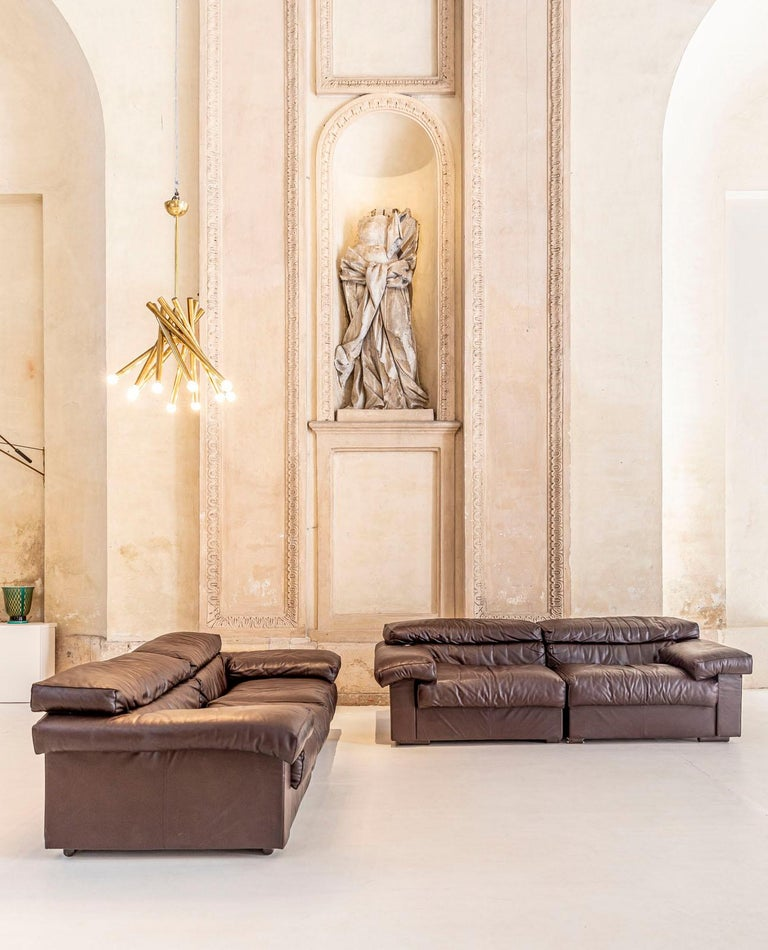 Exceptional pair of cognac leather sofa Erasmo designed by Afra & Tobia Scarpa for B&B. They usually come in two different sofas but the four parts can be also used all together. Very comfortable seats and leather in excellent condition.