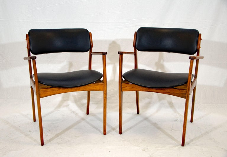 This iconic pair of armchairs designed by Erik Buck (Buch) would be very comfortable home office seating, as well as added guest seating around a dining table. They are very comfortable with padded backs and wide seats.