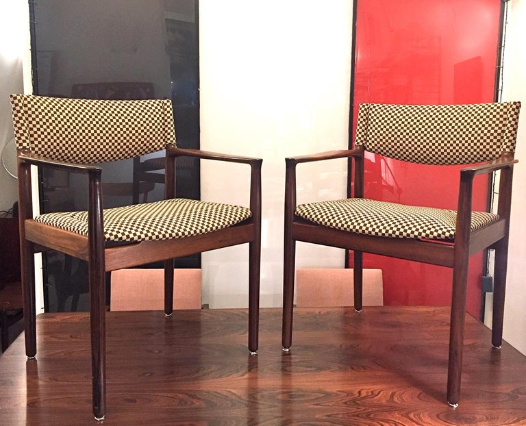 A pair of Brazilian rosewood armchairs designed by Erik Worts and edited by Vamo in 1960. Model 52A with back and seat reupholstered in Gerard Kvadrat fabric.