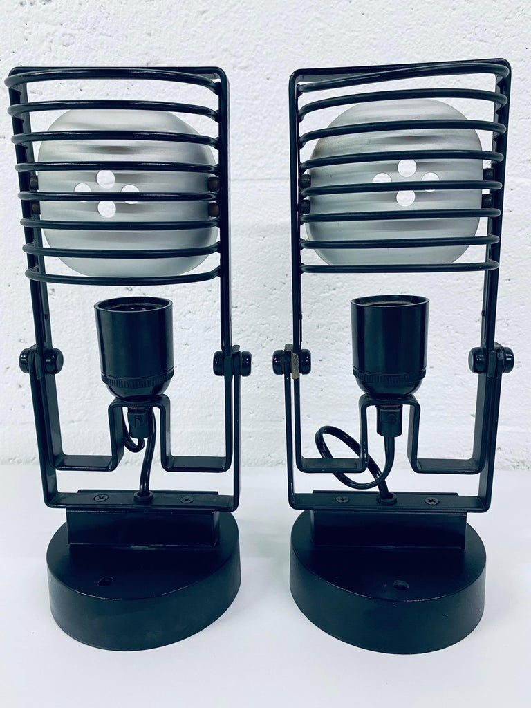 Rare pair of Ernesto Gismondi Sintesi adjustable wall scones for Artemide circa 1970s. Sconces rotate and tilt. No mounting plate required, only screws (not included).