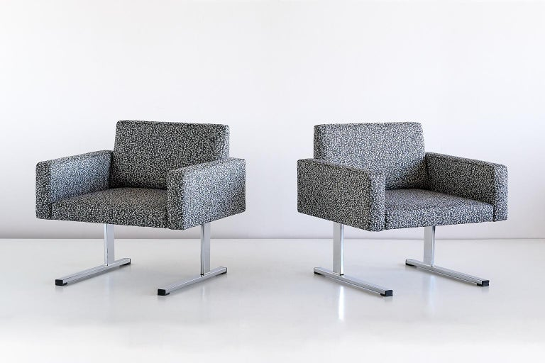 This exceptionally rare pair of lounge chairs was designed by Esko Pajamies and produced by the Finnish company Merva in the 1960s. The rectangular shape of the seat, armrests and backrest give the chair a geometric and modernist appearance. The