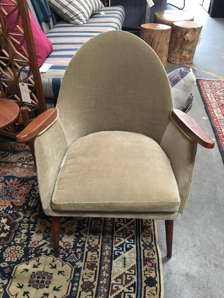 A pair of beautiful midcentury chairs from Europe in a light sage green velvet fabric.