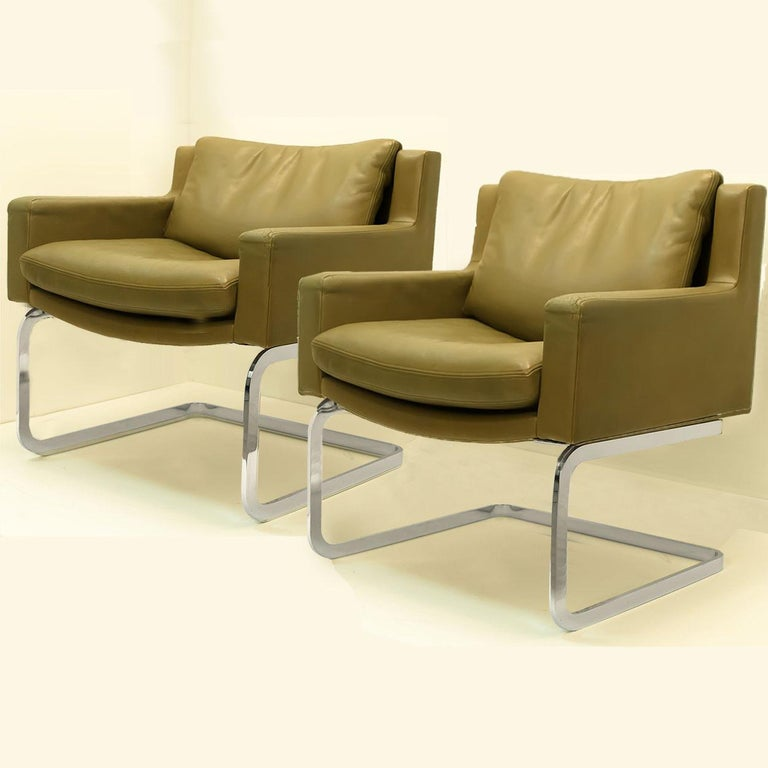 Pair of highly desirable armchairs and hocker designed by Robert Haussmann for De Sede of Switzerland, early 1960s. The collection was later distributed in the US by Stendig Furniture during the 1960s. Each extremely comfortable armchair is brought