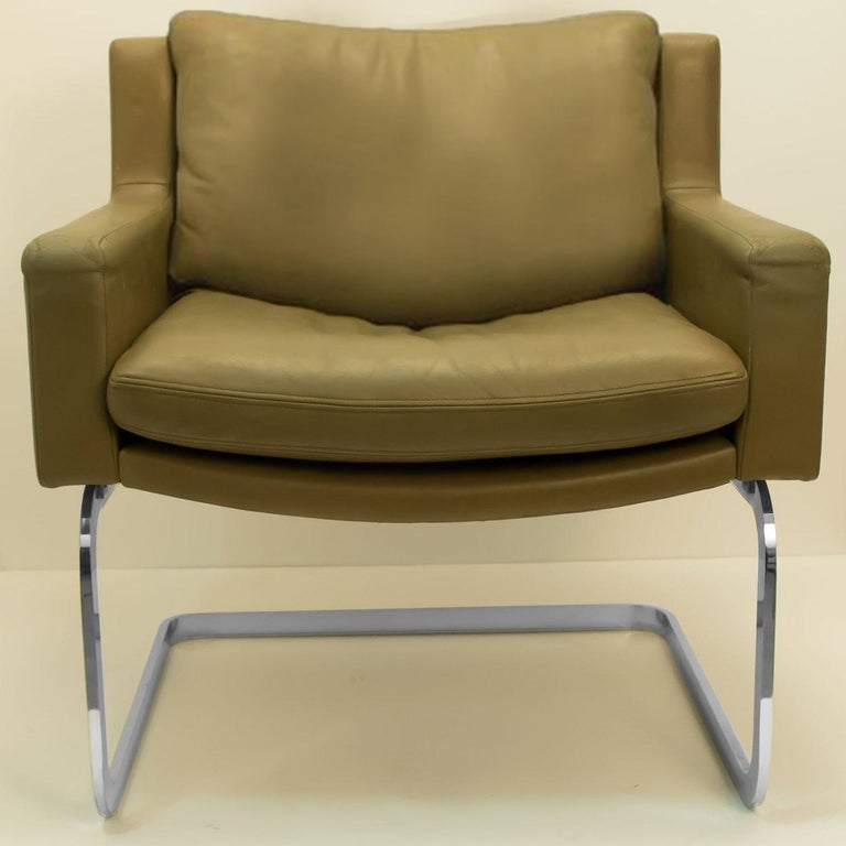 Swiss Pair of Executive Armchairs and Hocker by Robert Haussmann for the Sede For Sale