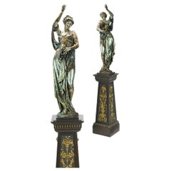 Pair of Exposition Neo-Grec Silvered and Gilt Bronze Figural Bacchante Torchères