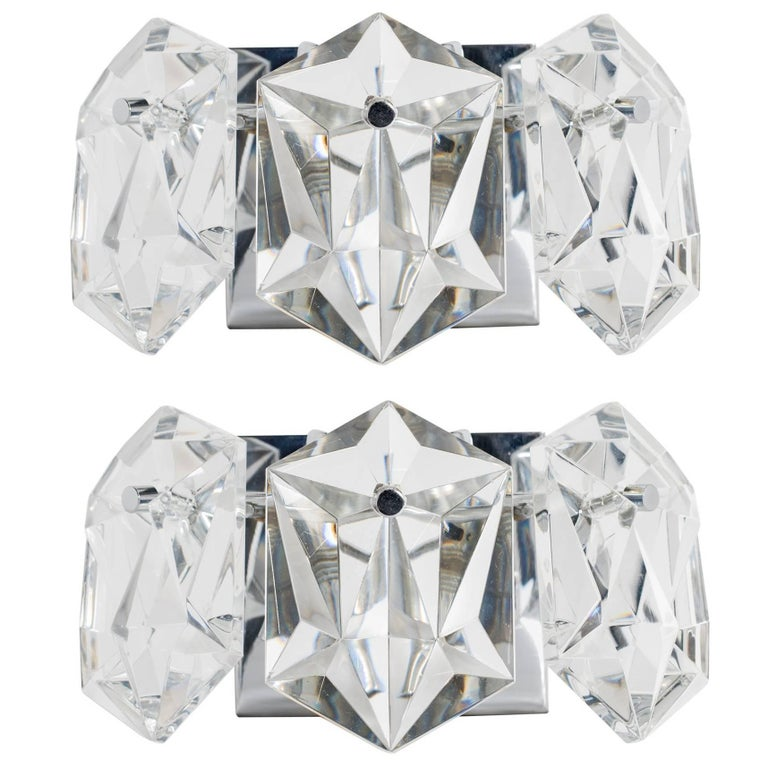 Exquisite pair of petite Mid-Century Modern sconces, fitted with three faceted crystal prisms. Simple floating frames are finished in polished nickel with matching fittings. Newly rewired and fitted with two lights each. Perfect scale for powder