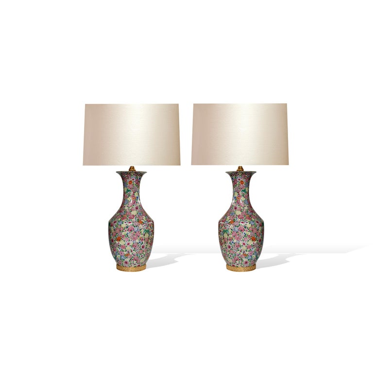 """Pair of finely painted famille rose porcelain lamps with flower blossom decoration.  To the top of the lamp body: 23""""/H.  (Lampshades not included)."""