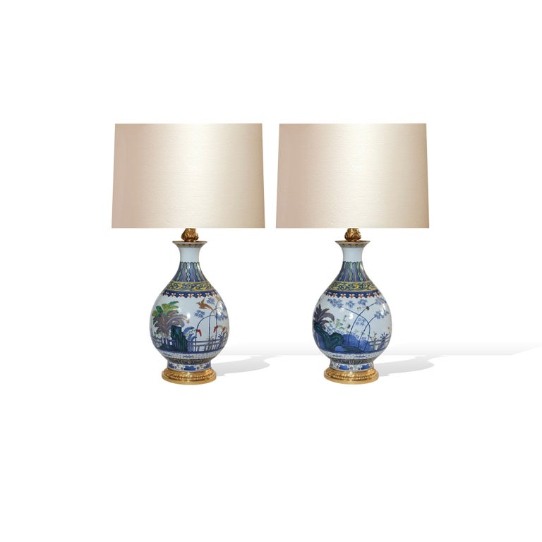 """Pair of Famille Rose porcelain lamps with cranes in the garden decoration. To the top of the lamp body: 14""""/H.  (Lampshades not included)."""