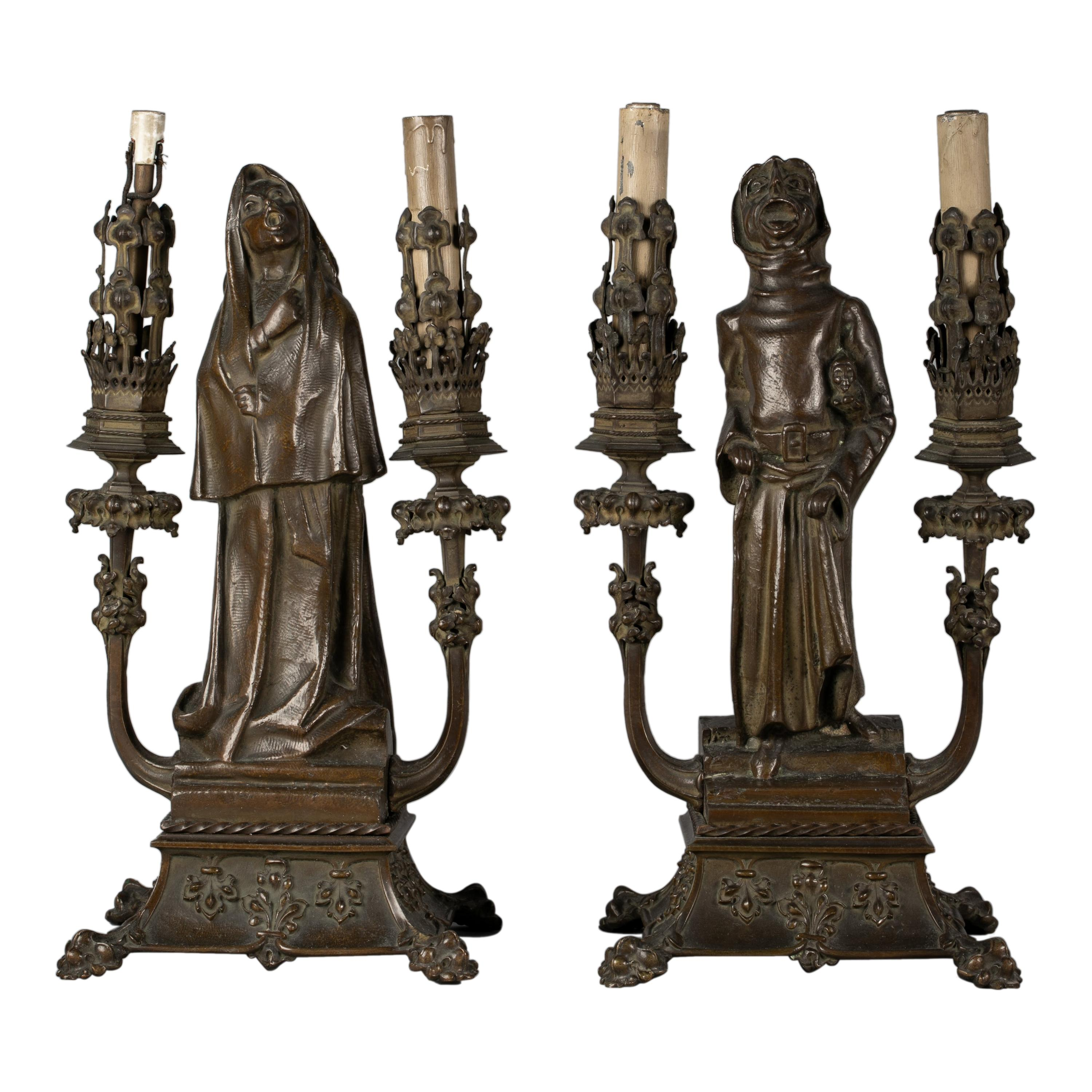 Pair of 'Fantasy' Patinated Bronze Two-Light Candelabra Lamps, circa 1910