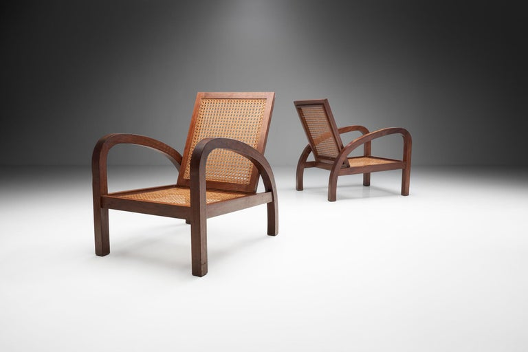 """These two so-called """"boat or cruise chairs"""" (fauteuils de paquebot in French) are not only visually arresting, but also interesting thanks to their historical use.  The chairs of this set are made of exotic wood and were used as deck chairs on"""