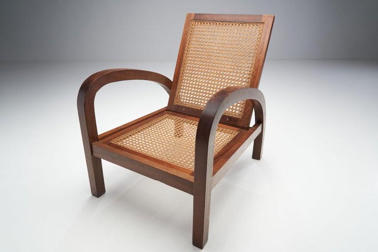 """Cane Pair of """"Fauteuils de Paquebot"""" Chairs, France, 1950s For Sale"""