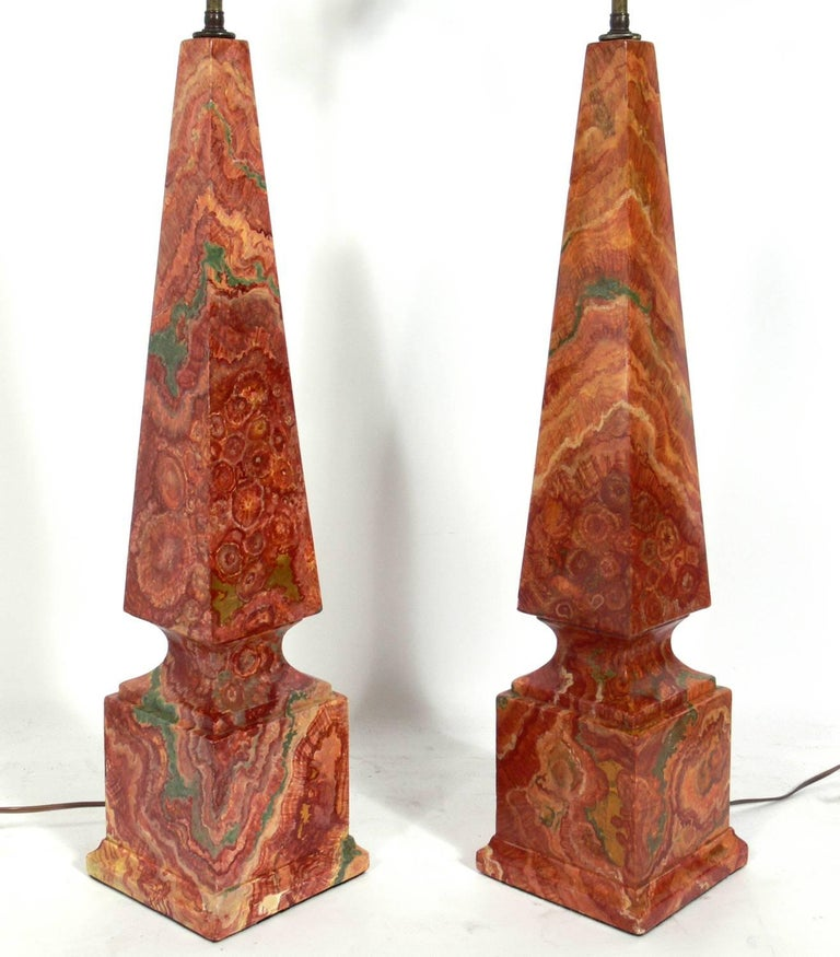 Pair of faux agate obelisk lamps, probably American, circa 1960s. These lamps are wonderfully executed and look like agate unless closely inspected. Rewired and ready to use. The price noted below includes the shades.