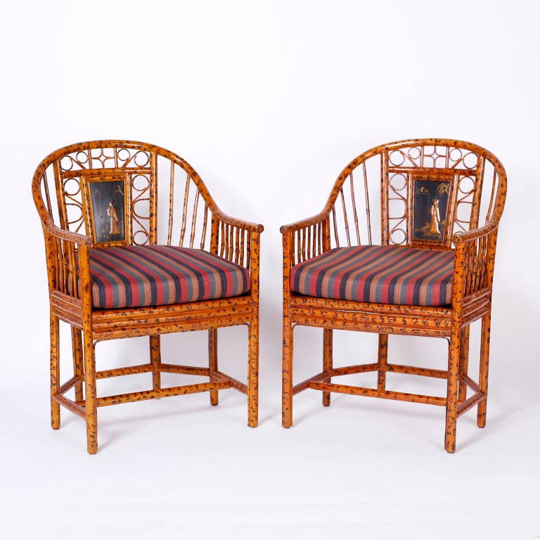 Handmade pair of Brighton Pavilion chairs with classic form featuring a faux burnt bamboo finish, caned seats, and lacquer panels with chinoiserie figures. Signed Maitland-Smith on the bottoms. 