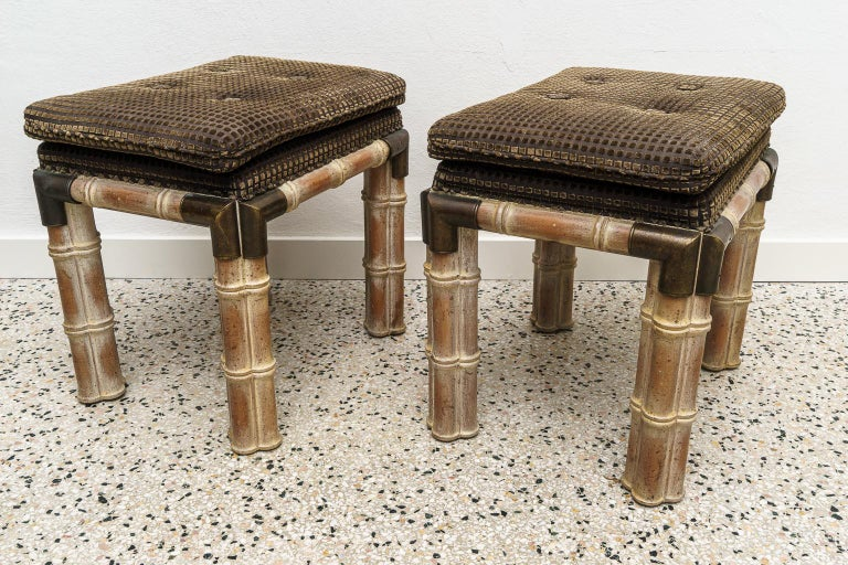 A pair of faux bamboo brown stools benches.  Note: There is a console table on our on our 1stdibs platform that complements these lovely stools LU928317853971.