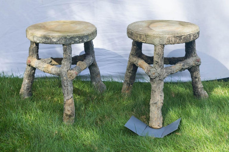 Artisan crafted matching pair of faux bois stools with beautiful patina.