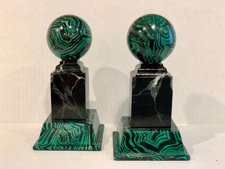 Pair of faux Malcihite Orbs by Bob Christian, 1987 Each one realistically painted wood, both signed Bob Christian, 1987 Famed Georgia decorator firm.