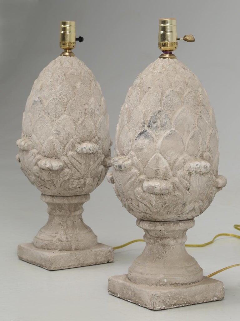 Pair of lamps done in a faux stone appearance, in the shape of an artichoke. Our in-house electrical department, has converted the pair of lamps to USA standards. Height was measured at the top of the socket.