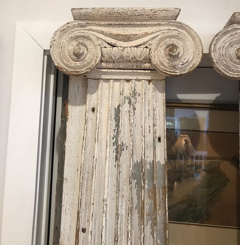 A pair of wood Federal period wall column pilasters. Completely handmade from the exterior of an early 19th century home from 1820s the old weathered paint with handmade nails and hand carved details.