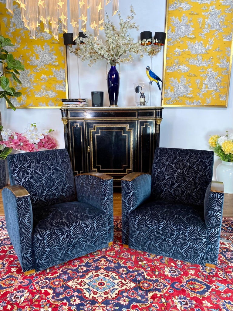 1930 pair of French Art Deco club chairs from France. Beautifully restored and reupholstered by our inhouse master upholsterer with Blue Velvet Nobilis fabric. Excellent condition.