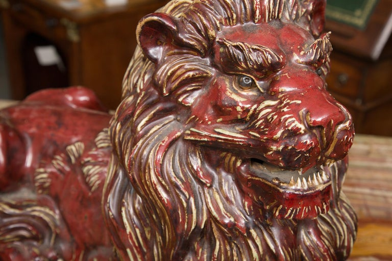 Pair of Fiance Glazed Recumbent Lions In Good Condition For Sale In WEST PALM BEACH, FL