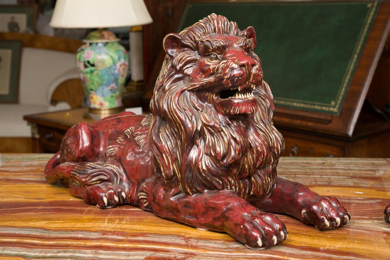 Faience Pair of Fiance Glazed Recumbent Lions For Sale